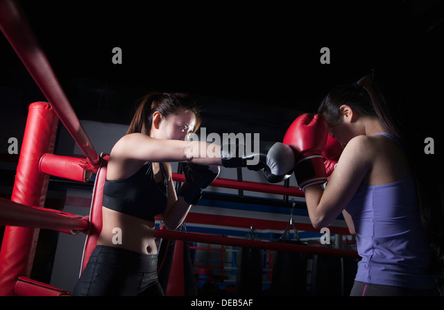 Two female boxers boxing in the boxing ring in Beijing, China - Stock Image