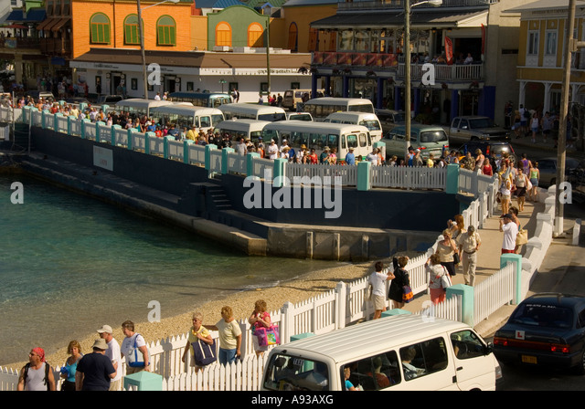 Grand Cayman George Town traffic jam minibus crowd overcrowded - Stock Image