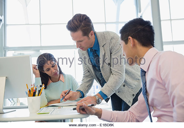 Business people meeting at desk in office - Stock-Bilder