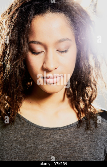 Close up of mid adult woman, eyes closed - Stock Image