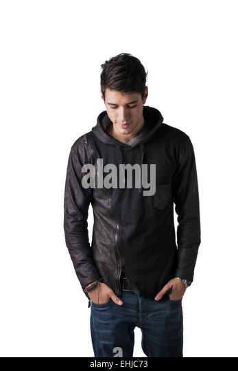 Handsome shyHandsome shy young man in black hoodie sweater standing, looking down, isolated on white young man in - Stock Image
