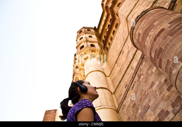 Young woman with Audioguide in Jodhpur - Stock-Bilder