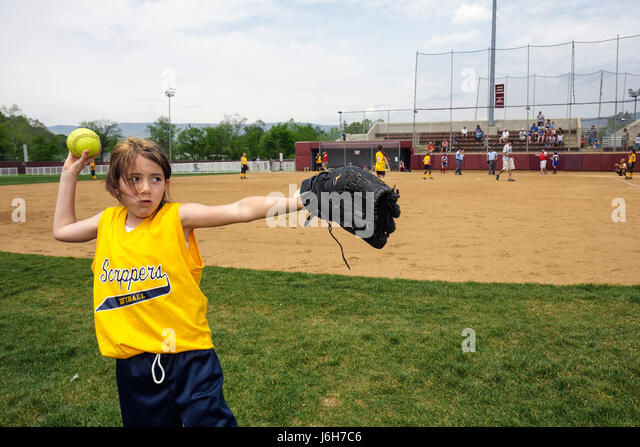 Virginia Salem Moyer Sports Complex baseball fields diamond girls softball game player throws ball glove mitt - Stock Image