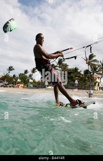 kite boarding at kite beach in the Dominican Republic - Stock Image
