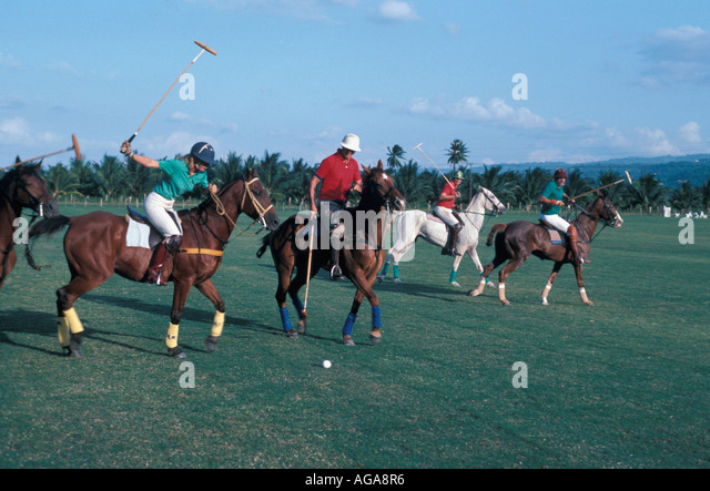 Jamaica Chukka Cove polo match players horses and mallets - Stock Image