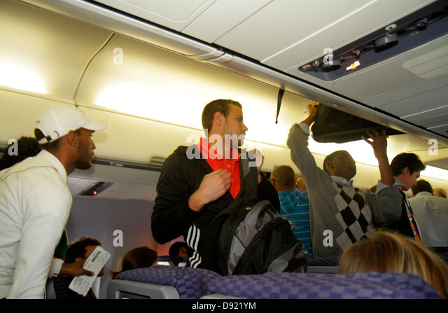 Texas Houston George Bush Intercontinental Airport IAH onboard cabin passengers arriving flight disembarking plane - Stock Image
