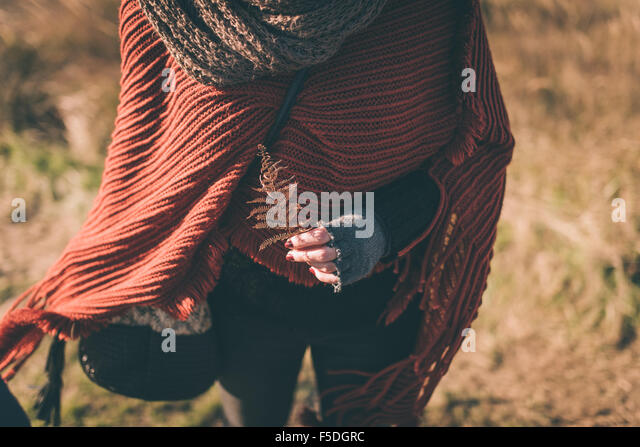 Woman in nature holding dry fern - Stock Image