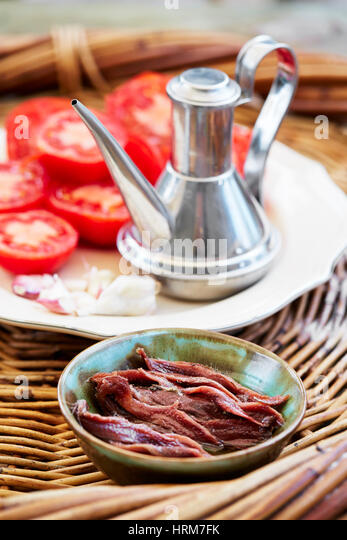 Garlic tomato, Anchovies and olive oil spanish ingredients - Stock Image