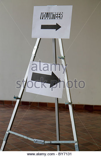 Miami Florida James L. Knight Convention Center sign volunteer - Stock Image
