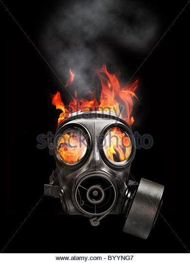gas mask and fire - Stock Image