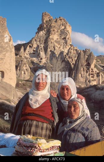 Turkey Cappadocia Uchisar souvenir vendors volcanic tufa formations beyond - Stock Image