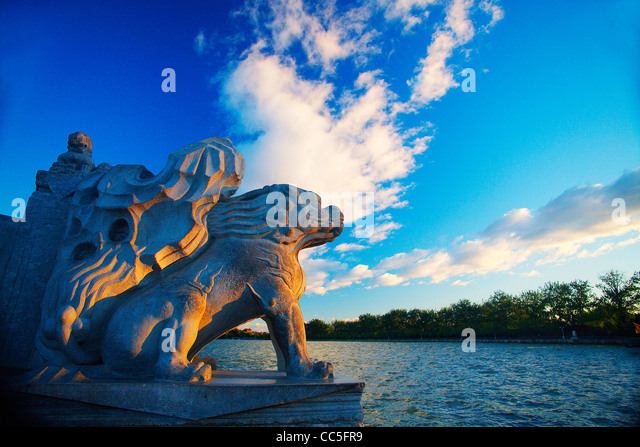 Stone sculpture of Qilin on the Seventeen-Arch Bridge, Summer Palace, Beijing, China - Stock Image