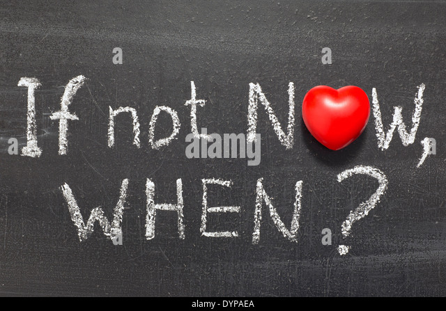 if not now, when question handwritten on chalkboard with heart symbol instead of O - Stock Image