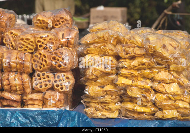 Spicy fried eatable packed in plastic bags ; Nedumgolam ; Quilon Kollam ; Kerala ; India 2010 - Stock Image