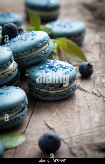 Close up of blueberry macaroons with white filling - Stock Image