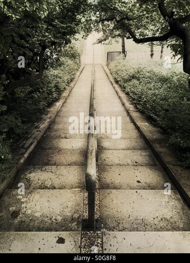 Stairs at Parc de Bercy with fresh Spring foliage in Paris, France. Vintage sepia tones. - Stock Image