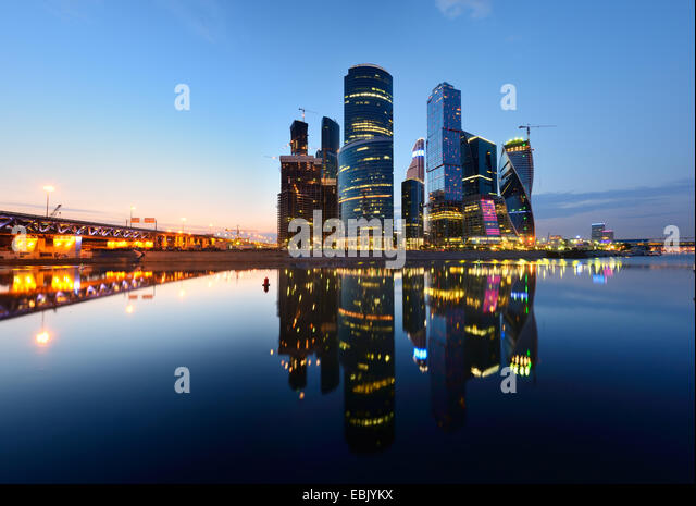 View of skyscrapers on Moskva river waterfront at night, Moscow, Russia - Stock Image