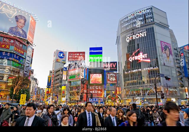 Shibuya Crossing Hachiko Square Tokyo Skyline Japan Neon Advertising Billboards - Stock Image