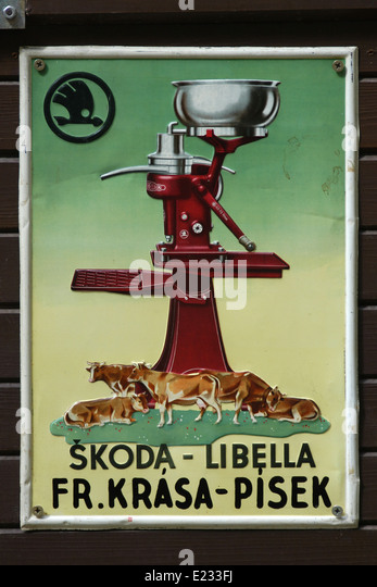 Vintage advertisement for the Skoda manual milk separators in an antique shop in Cesky Krumlov in South Bohemia, - Stock Image