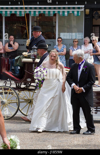 Bride arrives in a horse drawn carriage - Stock Image