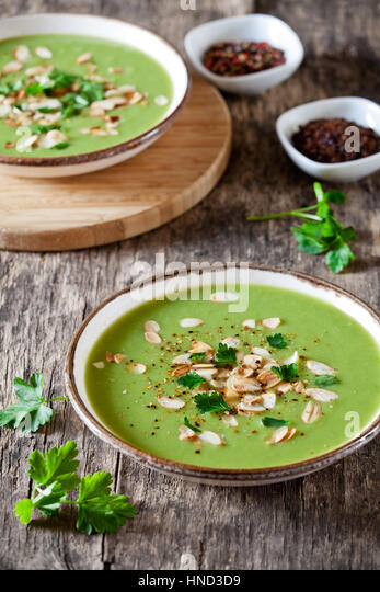 Couple of bowls of homemade pea and leek soup - Stock Image