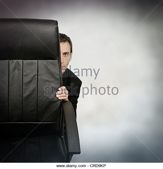 hiding businessman - Stock Image