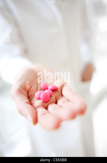 MODEL RELEASED. Pills in a doctor's hand. - Stock Image