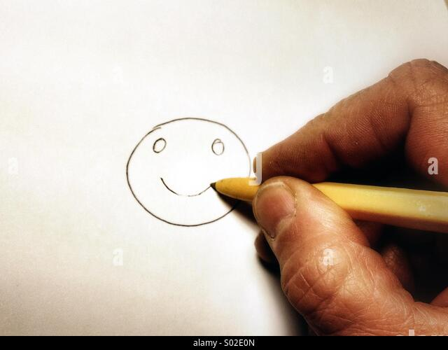 Drawing smiley face - Stock Image