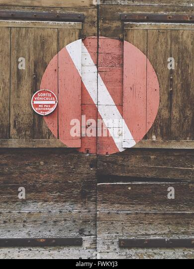 No Entry Sign On Closed Wooden Door - Stock Image