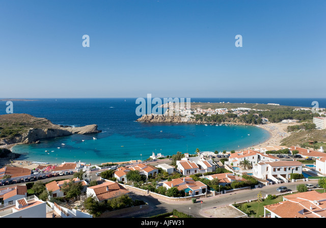 Modern development and beach at Arenal d'en Castell, Menorca, Spain - Stock Image