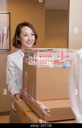 Online seller delivering boxes - Stock Image