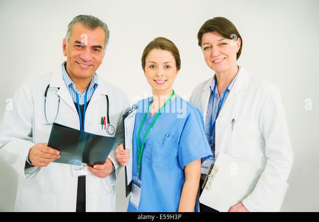 Portrait of confident doctors and nurse - Stock Image