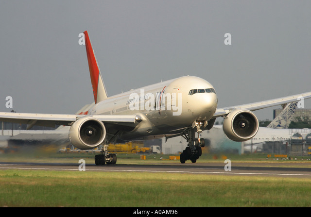 Difficult landing with strong crosswind of Japan Airlines JAL Boeing 777 246 ER JA706J at London Heathrow UK - Stock Image