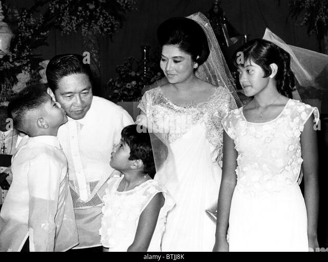 Ferdinand Marcos (second from left), 10th President of the Philippines, and family: Ferdinand Marcos Jr. (left), - Stock Image