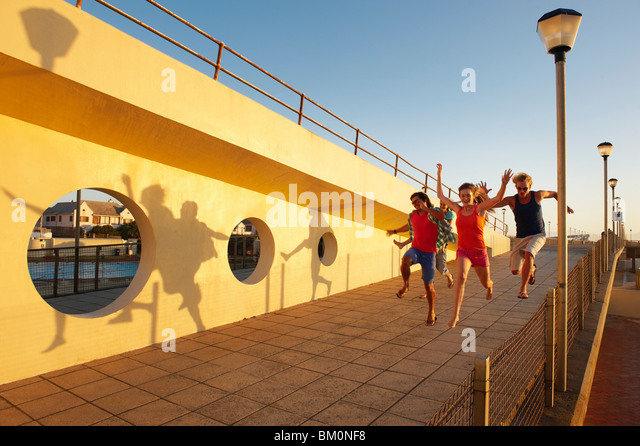 Happy young people leaping - Stock Image