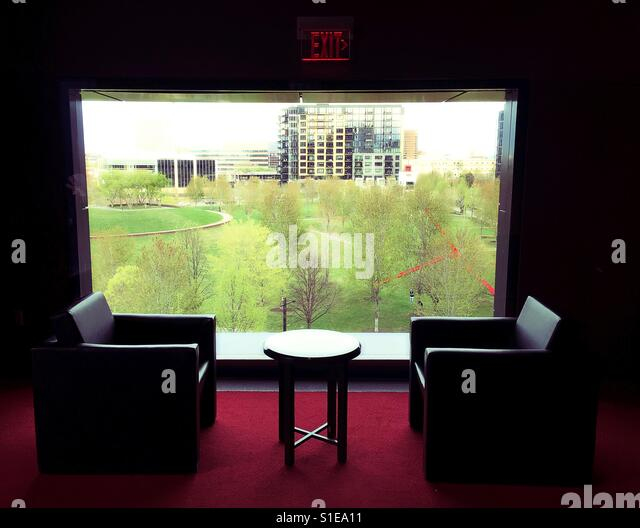 Chairs and table next to a picture window at the Guthrie Theater in Minneapolis, Minnesota, USA. - Stock Image