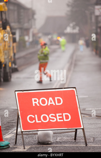 Resurfacing work taking place in Ambleside after floods and harsh winter weather caused serious erosion of the road - Stock-Bilder