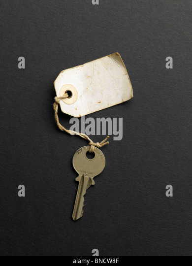 Old key with label no writing - Stock-Bilder