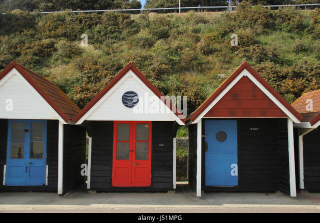 Bournemouth, UK -  11 May: An array of beach huts located on Bournemouth beach. General view of the seaside town - Stock Image