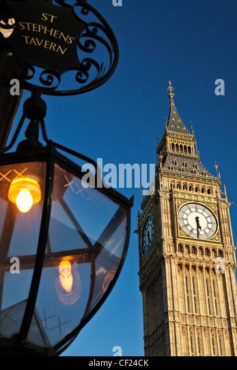 A lantern hanging outside St Stephens Tavern opposite Big Ben. - Stock Image