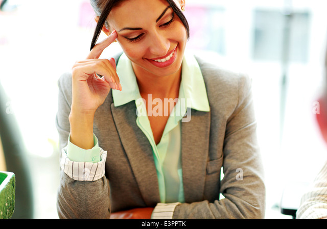 Portrait of a cheerful businesswoman in office - Stock Image