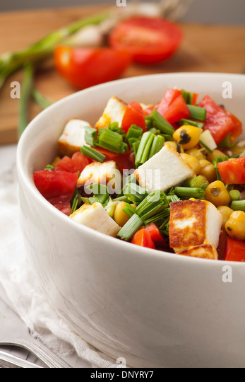 Fresh salad with tomatoes garlic and chickpea - Stock Image