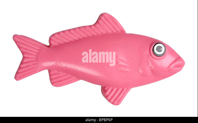 Pink plastic fish - Stock Image