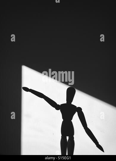 Silhouette of a wood doll - Stock-Bilder