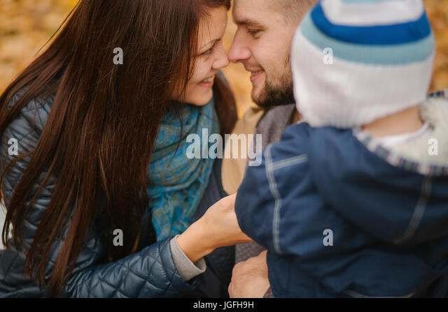 Affectionate Middle Eastern couple with baby son - Stock Image
