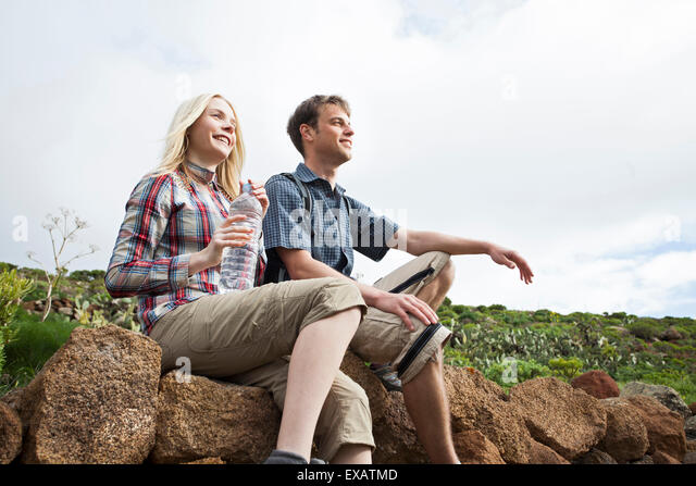 young couple with travelling break on the Canaries - Stock-Bilder