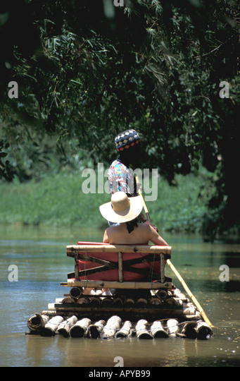 Jamaica Woman River Rafting on Martha Brae River near Falmouth and Montego Bay - Stock Image