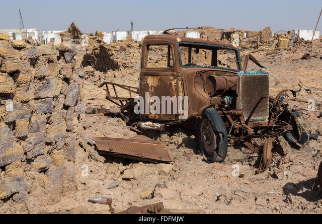 A rusting truck slowly rots away in the abandoned Italian mining camp near Dallol in Ethiopia. - Stock Image