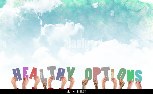 Composite image of hands holding up healthy options - Stock Image