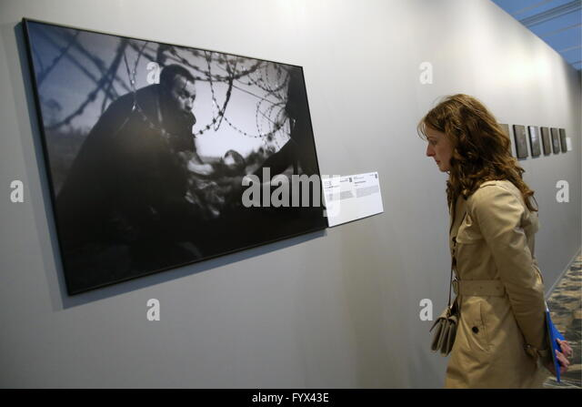 Moscow, Russia. 28th Apr, 2016. World Press Photo of the Year, Hope for a New Life taken by Australian photographer - Stock Image